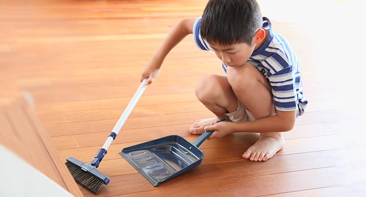 Child Cleaning Floor
