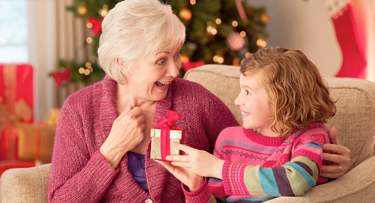 Girl Giving Present To Grandmother